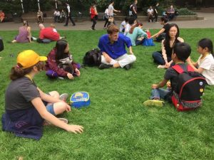 Children and Athena Tuition tutor having a picnic at the Natural History Museum