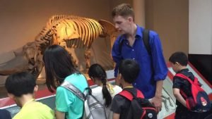 Children and Athena Tuition tutor at the Natural History Museum in London