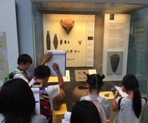 Top 10 apps for students - children looking at exhibit at the British Museum in London.